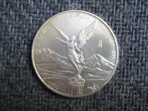 Monedas de plata y oro antiguas y modernos