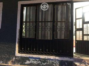 Ventana con puerta de aluminio