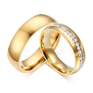 Par de anillos dorados compromiso pareja de acero inoxidable