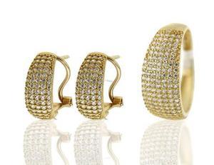 Juego de aretes y anillo cubiertos en circonias oro 14 k