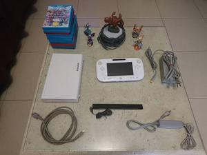 Consola wii u color blanco con 10 juegos originales.