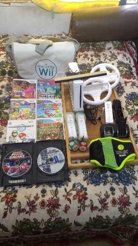 Wii con juegos, accesorios y mochila originales