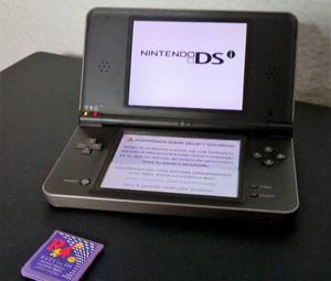 Nintendo dsi xl con tarjeta rt4 con más de 20 juegos