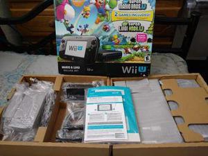 Nintendo wii u deluxe con caja manual y 15 juegos integrados