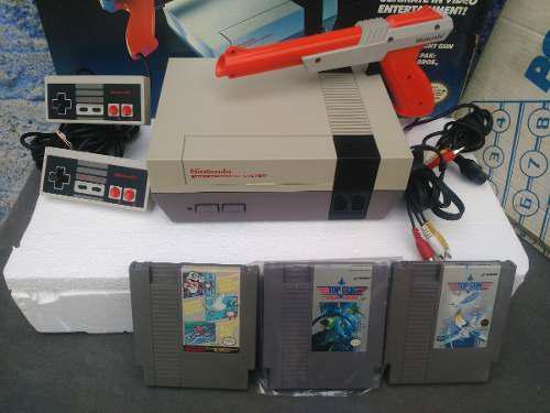 Nintendo nes con caja volante y tapete con juegos