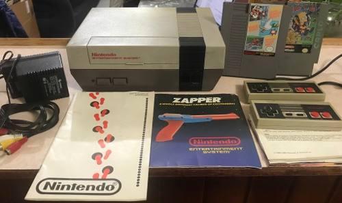 Nintendo nes, eliminador, cable rca, 2 controles, 2 juegos