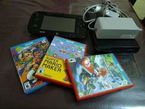 Wii u de 32 gb, usada, con tres juegos originales