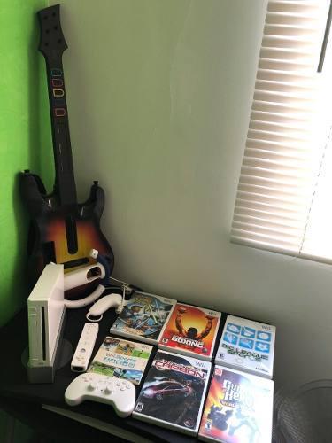 Nintendo wii + guitar hero + guitarra + 5 juegos