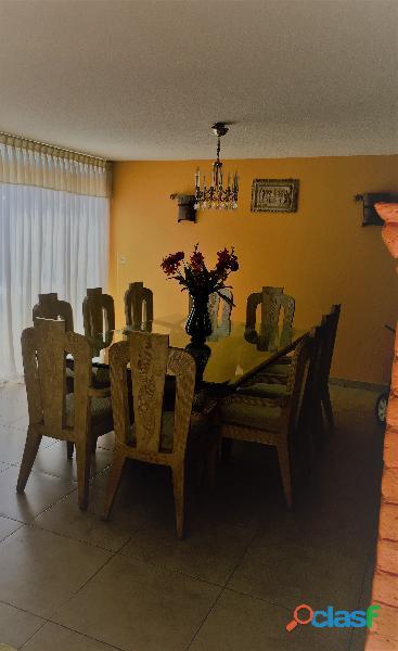 Comedor con bases de cantera y 10 sillas