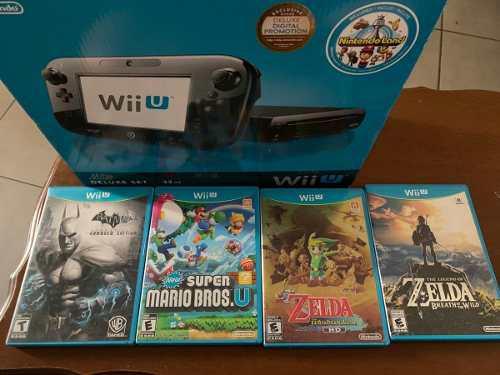 Nintendo wii u deluxe set (32 gb) + 4 juegos