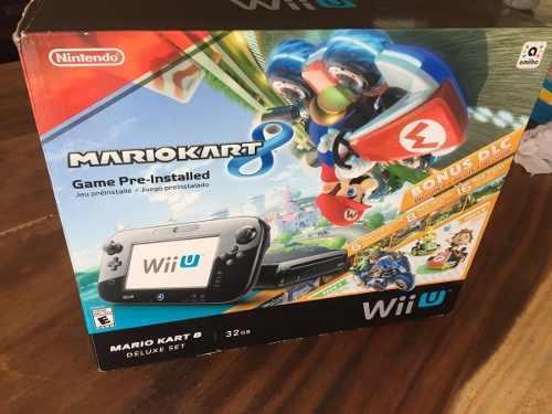 Nintendo wiiu delux mariokart 8 32g + 5 juegos y 2 controles