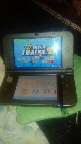 Nintendo 3d color gris tactil y con tres juegos.