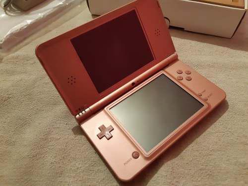 Nintendo dsi xl rosa metalico 2 juegos