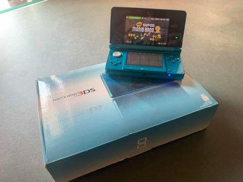 Nintendo 3ds azul aqua con videojuegos