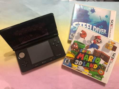 Nintendo 3ds, color negro, semi-nuevo e incluye 2 juegos