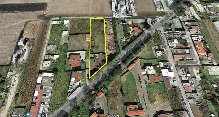Terreno con construcción en venta a pie de carretera
