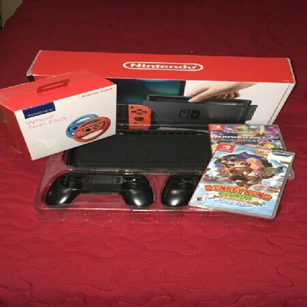 Nintendo switch con kit de funda volantes y dos juegos