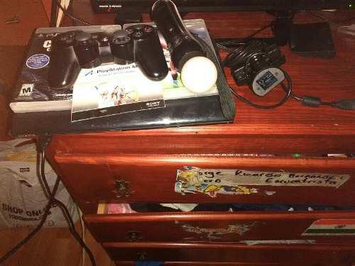 Play station 3 color negro dos juegos y un control