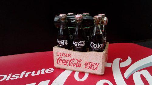 Coca cola mini rejita con 7 botellitas