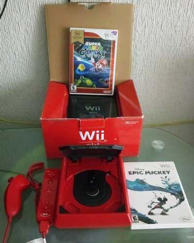 Wii mini completo caja, cables y folletos, con 2 juegos.