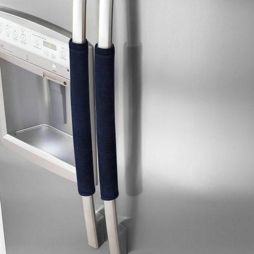Un par de tapas de manija de frigorífico para