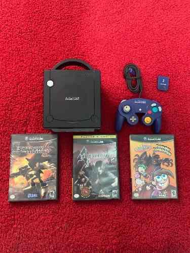 Game cube con accesorios y juegos.