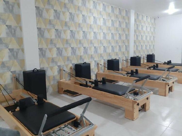 Fabrico equipo de pilates de madera, cama reformer clasico