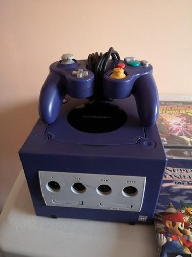 Nintendo game cube y varios juegos