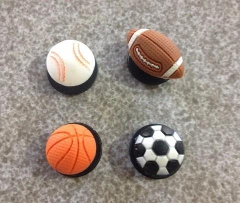 4 jibbitz de balones.futbol, basquet beis y americano. pins