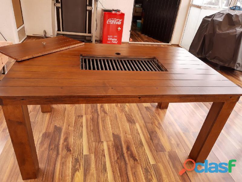Novedosa mesa con asador