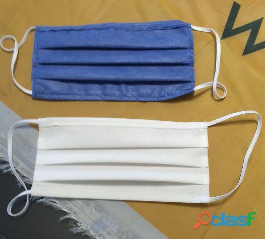 Cubrebocas de tela lavable y desechables