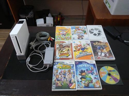 Nintendo wii usado con juegos, cables y control.