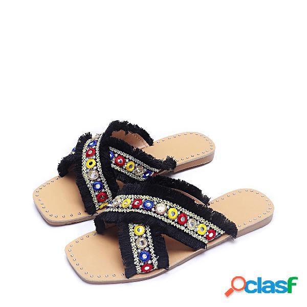 Zapatillas de diseño con borlas negras de tassel