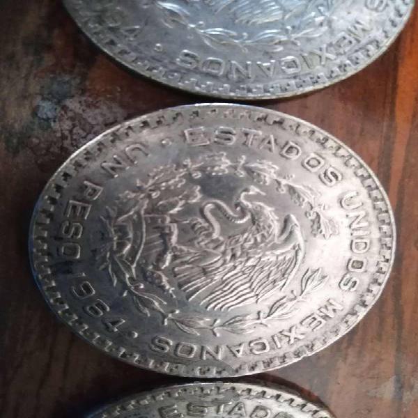 Monedas antiguas de 1957 y 1964 de un peso