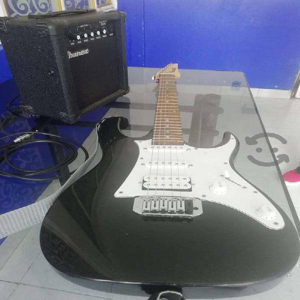 Guitarra ibanez con amplificador