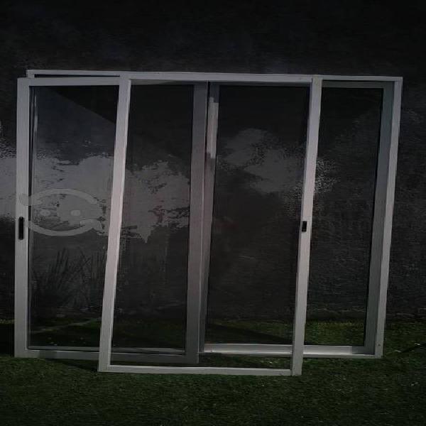 Puerta corrediza con marco y mosquitero
