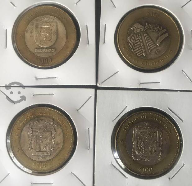 Moneda $100 con centro de plata