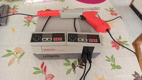 Nintendo nes original + zapper + 7 juegos + multijuegos
