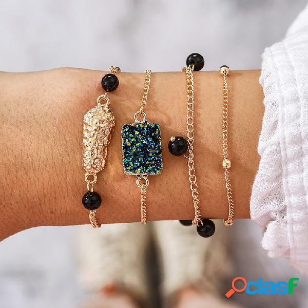 Vendimia pulsera de piedras preciosas irregulares de metal colgante pulsera de cuentas negras con borla de múltiples capas
