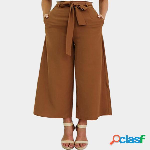 Pantalones acampanados de talle alto color caqui con cintura ajustada