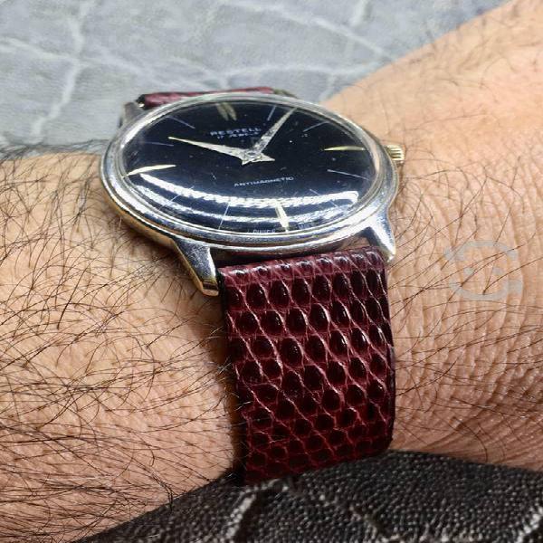 Antiguo reloj suizo extraplano 50s