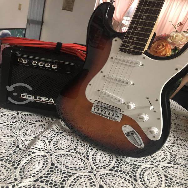 Guitarra eléctrica con amplificador (poco uso)