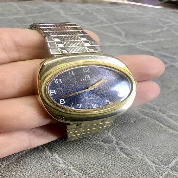 Antiguo reloj alfa suizo