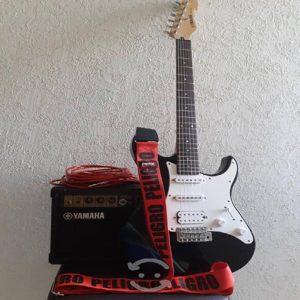 Guitarra electrica yamaha con amplificador.