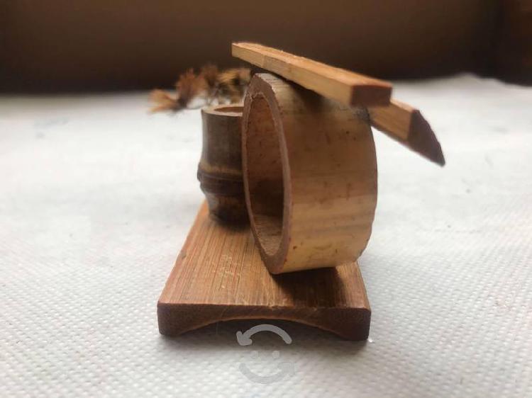 Adorno de bambú, pato salvaje y cantarito de oax.