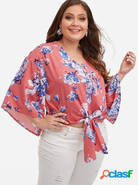 Blusa con mangas de campana y lazo de estampado floral