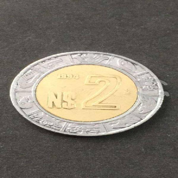 Moneda de $2 con detalle nuevos pesos
