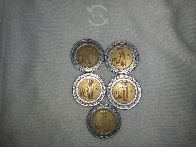 Monedas nuevos pesos con error de fecha