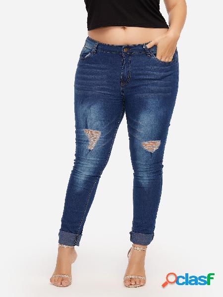 Jeans skinny rasgados al azar azul oscuro