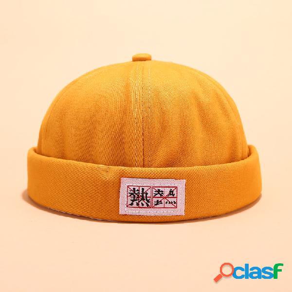 Hombre mujer sombreros sin ala de algodón de color liso cráneo gorras con letras chinas